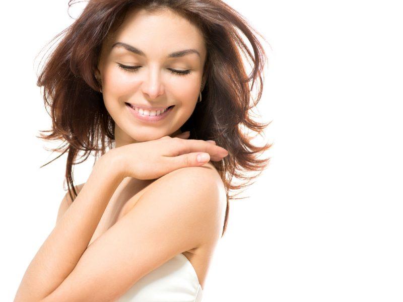 25594203 - beauty woman  beautiful young female touching her skin