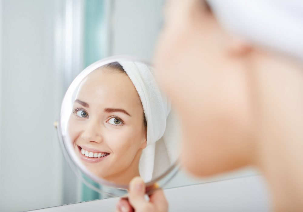 51686371 - face of young beautiful healthy woman and reflection in the mirror